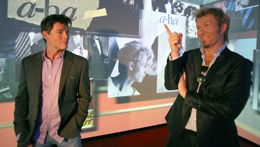 """How on earth could you wear that, Morten?"" Magne studies old a-ha photos at the Rockheim museum in Trondheim today. (Picture from NRK Trøndelag)"