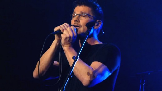 Morten, sporting a Movember moustache, on stage in Oslo last night (Screenshot from YouTube video)